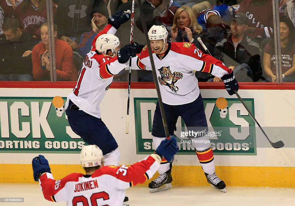 <a gi-track='captionPersonalityLinkClicked' href=/galleries/search?phrase=Brad+Boyes&family=editorial&specificpeople=275014 ng-click='$event.stopPropagation()'>Brad Boyes</a> #24 of the Florida Panthers celebrates his game winning goal in overtime with <a gi-track='captionPersonalityLinkClicked' href=/galleries/search?phrase=Jonathan+Huberdeau&family=editorial&specificpeople=7144196 ng-click='$event.stopPropagation()'>Jonathan Huberdeau</a> #11 and <a gi-track='captionPersonalityLinkClicked' href=/galleries/search?phrase=Jussi+Jokinen&family=editorial&specificpeople=570599 ng-click='$event.stopPropagation()'>Jussi Jokinen</a> #36 of the Florida Panthers against goalie Reto Berra #20 of the Colorado Avalanche at Pepsi Center on October 21, 2014 in Denver, Colorado. The Panthers defeated the Avalanche 4-3 in overtime.