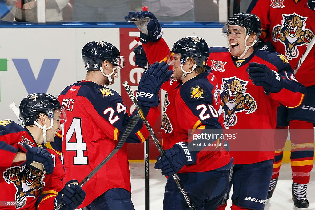 <a gi-track='captionPersonalityLinkClicked' href=/galleries/search?phrase=Brad+Boyes&family=editorial&specificpeople=275014 ng-click='$event.stopPropagation()'>Brad Boyes</a> #24 of the Florida Panthers celebrates his shootout goal with his teammates aaginst the Detroit Red Wings at the BB&T Center on December 10, 2013 in Sunrise, Florida.