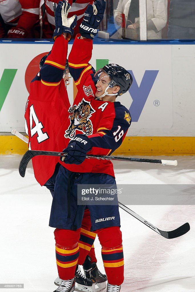 <a gi-track='captionPersonalityLinkClicked' href=/galleries/search?phrase=Brad+Boyes&family=editorial&specificpeople=275014 ng-click='$event.stopPropagation()'>Brad Boyes</a> #24 of the Florida Panthers celebrates his shootout goal with teammate <a gi-track='captionPersonalityLinkClicked' href=/galleries/search?phrase=Scottie+Upshall&family=editorial&specificpeople=209198 ng-click='$event.stopPropagation()'>Scottie Upshall</a> #19 against the Detroit Red Wings at the BB&T Center on December 10, 2013 in Sunrise, Florida.