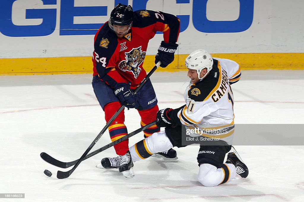 <a gi-track='captionPersonalityLinkClicked' href=/galleries/search?phrase=Brad+Boyes&family=editorial&specificpeople=275014 ng-click='$event.stopPropagation()'>Brad Boyes</a> #24 of the Florida Panthers crosses sticks with <a gi-track='captionPersonalityLinkClicked' href=/galleries/search?phrase=Gregory+Campbell&family=editorial&specificpeople=640895 ng-click='$event.stopPropagation()'>Gregory Campbell</a> #11 of the Boston Bruins at the BB&T Center on October 17, 2013 in Sunrise, Florida.