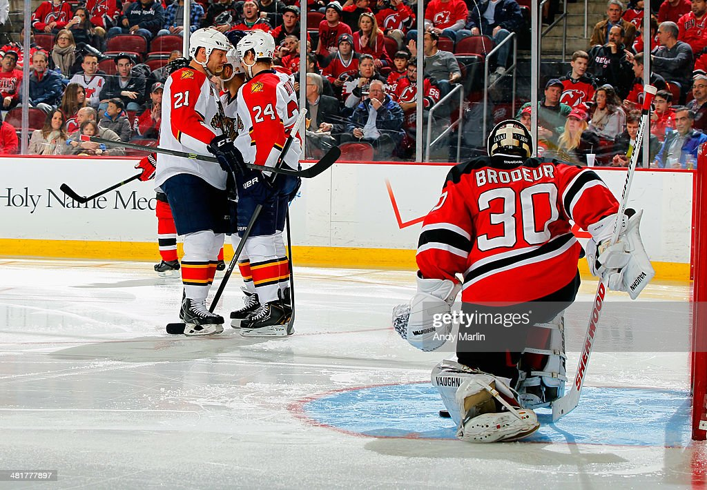 Brad Boyes of the Florida Panthers is congratulated by teammate Krys Barch after scoring a secondperiod goal as Martin Brodeur of the New Jersey...