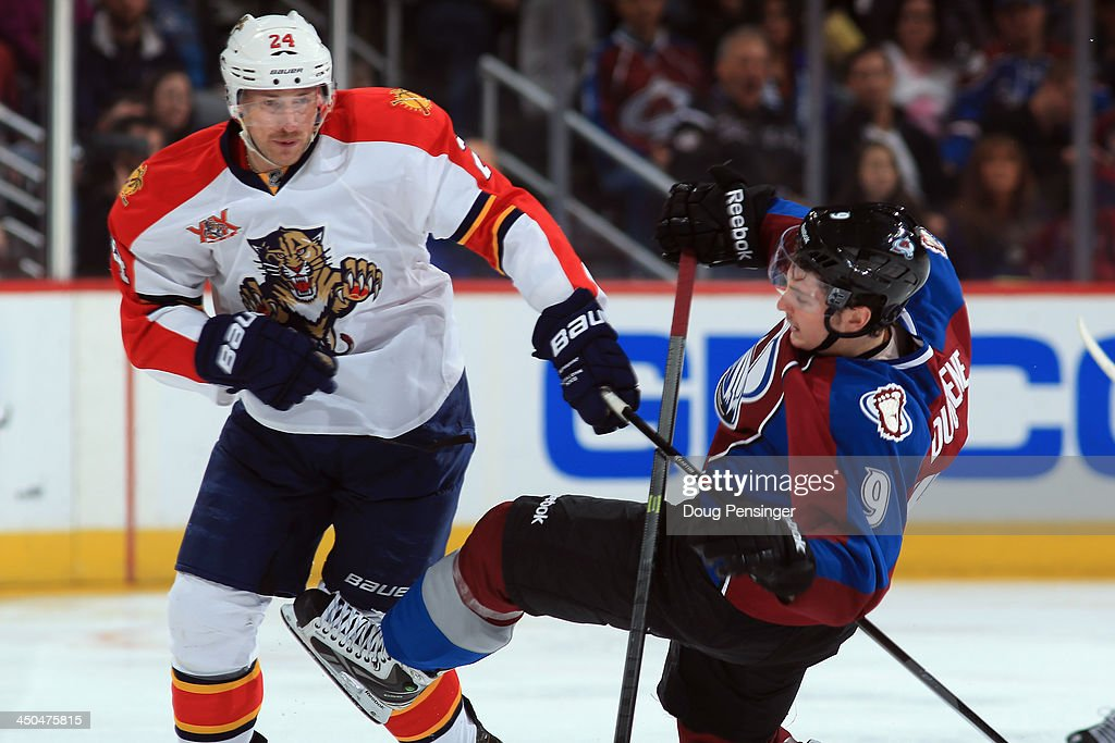 <a gi-track='captionPersonalityLinkClicked' href=/galleries/search?phrase=Brad+Boyes&family=editorial&specificpeople=275014 ng-click='$event.stopPropagation()'>Brad Boyes</a> #24 of the Florida Panthers puts a hot on <a gi-track='captionPersonalityLinkClicked' href=/galleries/search?phrase=Matt+Duchene&family=editorial&specificpeople=4819304 ng-click='$event.stopPropagation()'>Matt Duchene</a> #9 of the Colorado Avalanche at Pepsi Center on November 16, 2013 in Denver, Colorado. The Panthers defeated the Avalanche 4-1.