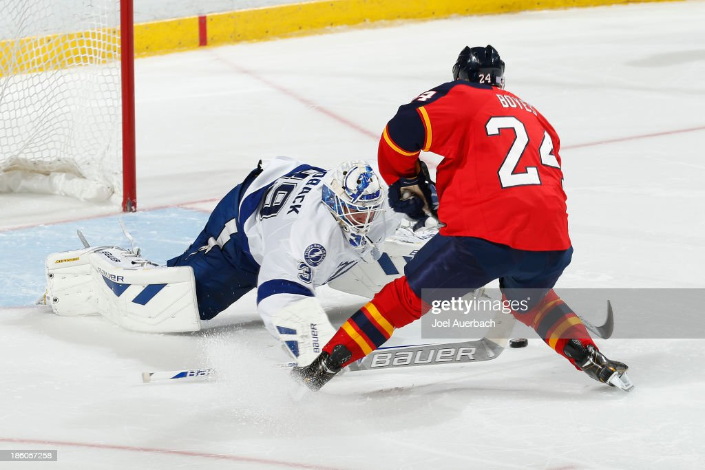 <a gi-track='captionPersonalityLinkClicked' href=/galleries/search?phrase=Brad+Boyes&family=editorial&specificpeople=275014 ng-click='$event.stopPropagation()'>Brad Boyes</a> #24 of the Florida Panthers scores a goal during the shoot-out past goaltender <a gi-track='captionPersonalityLinkClicked' href=/galleries/search?phrase=Anders+Lindback&family=editorial&specificpeople=7211274 ng-click='$event.stopPropagation()'>Anders Lindback</a> #39 of the Tampa Bay Lightning at the BB&T Center on October 27, 2013 in Sunrise, Florida. The Lightning defeated the Panthers 4-3 in a shoot-out