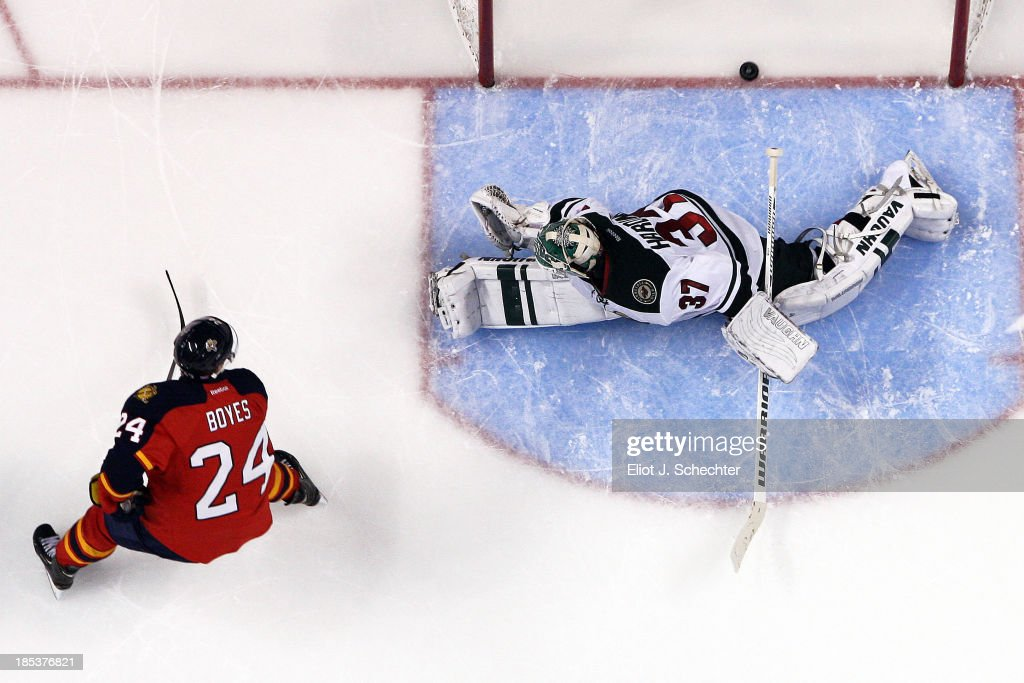 <a gi-track='captionPersonalityLinkClicked' href=/galleries/search?phrase=Brad+Boyes&family=editorial&specificpeople=275014 ng-click='$event.stopPropagation()'>Brad Boyes</a> #24 of the Florida Panthers scores against goaltender <a gi-track='captionPersonalityLinkClicked' href=/galleries/search?phrase=Josh+Harding&family=editorial&specificpeople=700587 ng-click='$event.stopPropagation()'>Josh Harding</a> #37 of the Minnesota Wild in a shoot out at the BB&T Center on October 19, 2013 in Sunrise, Florida.