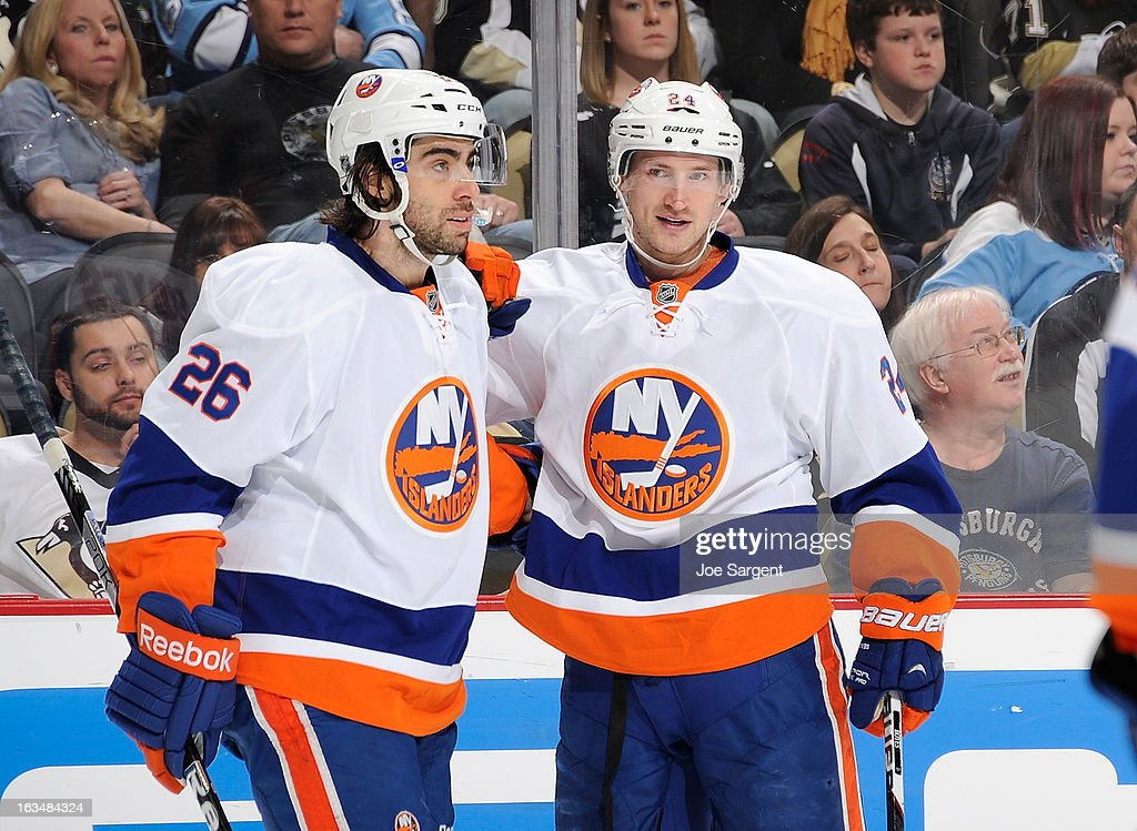 <a gi-track='captionPersonalityLinkClicked' href=/galleries/search?phrase=Brad+Boyes&family=editorial&specificpeople=275014 ng-click='$event.stopPropagation()'>Brad Boyes</a> #24 of the New York Islanders celebrates his goal with <a gi-track='captionPersonalityLinkClicked' href=/galleries/search?phrase=Matt+Moulson&family=editorial&specificpeople=3365493 ng-click='$event.stopPropagation()'>Matt Moulson</a> #26 during the game against the Pittsburgh Penguins on March 10, 2013 at Consol Energy Center in Pittsburgh, Pennsylvania.