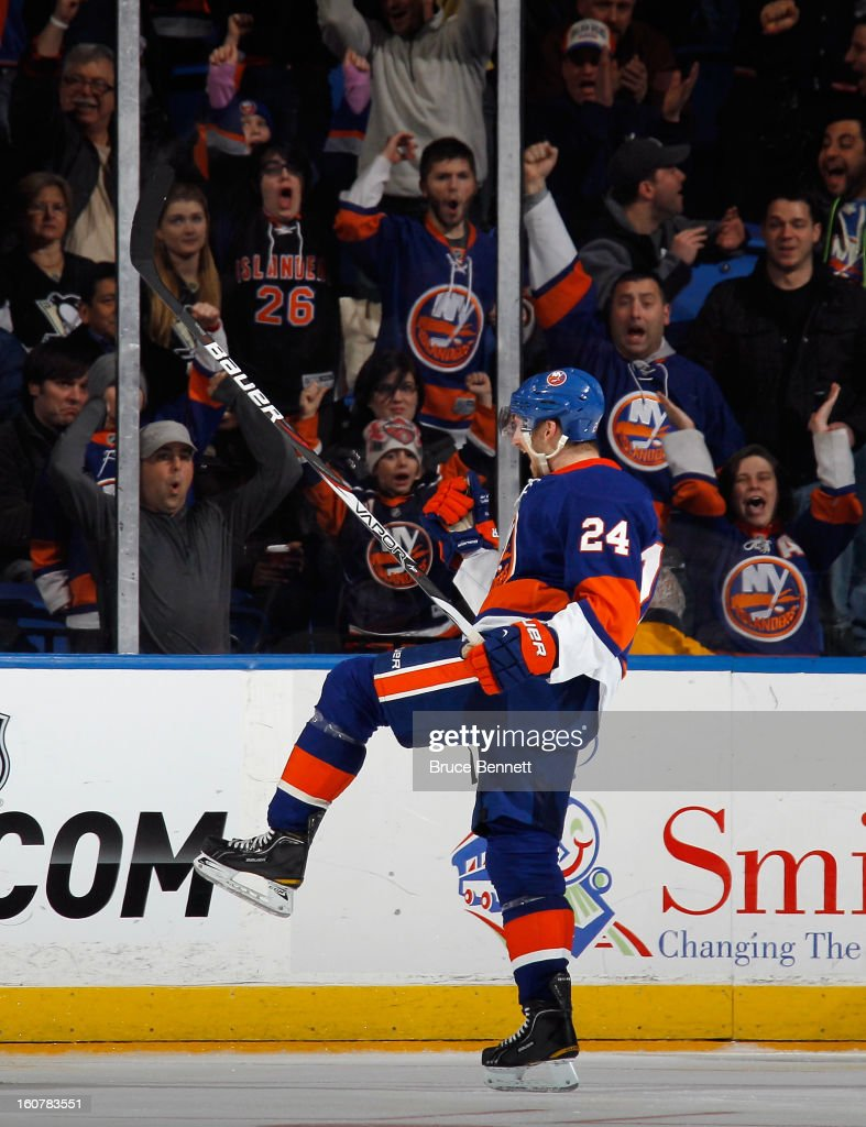 Brad Boyes #24 of the New York Islanders celebrates his third period goal against the Pittsburgh Penguins at the Nassau Veterans Memorial Coliseum on February 5, 2013 in Uniondale, New York. The Penguins defeated the Islanders 4-2.