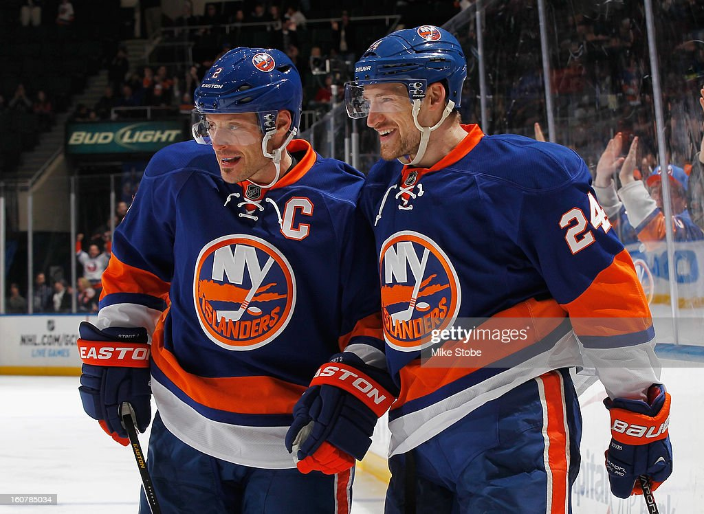 Brad Boyes #24 of the New York Islanders celebrates his third period goal with teammate Mark Streit #2 during the game against the Pittsburgh Penguins at Nassau Veterans Memorial Coliseum on February 5, 2013 in Uniondale, New York. The Penguins defeated the Islanders 4-2.