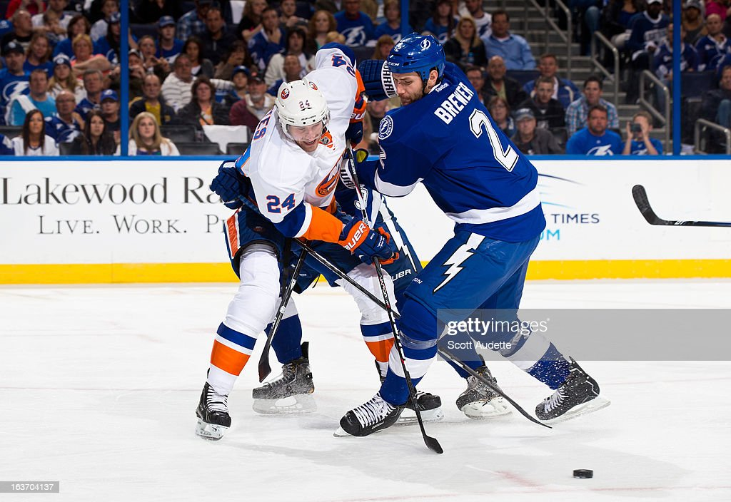 <a gi-track='captionPersonalityLinkClicked' href=/galleries/search?phrase=Brad+Boyes&family=editorial&specificpeople=275014 ng-click='$event.stopPropagation()'>Brad Boyes</a> #24 of the New York Islanders fights for control of the puck with <a gi-track='captionPersonalityLinkClicked' href=/galleries/search?phrase=Eric+Brewer&family=editorial&specificpeople=202144 ng-click='$event.stopPropagation()'>Eric Brewer</a> #2 of the Tampa Bay Lightning during the second period of the game at the Tampa Bay Times Forum on March 14, 2013 in Tampa, Florida.