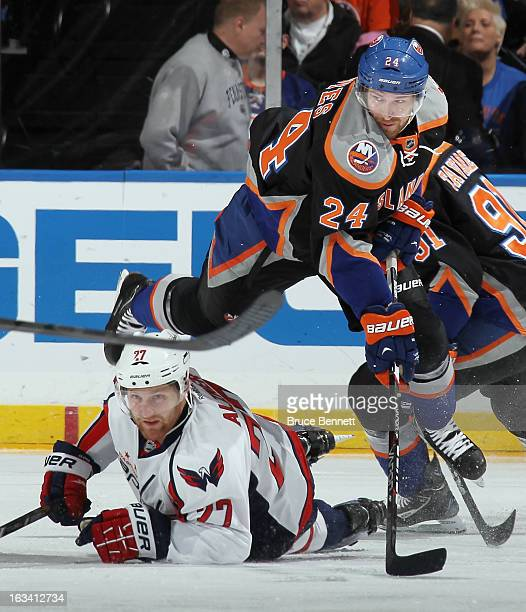 Brad Boyes of the New York Islanders jumps out of the way of a sliding Karl Alzner of the Washington Capitals during the first period at the Nassau...