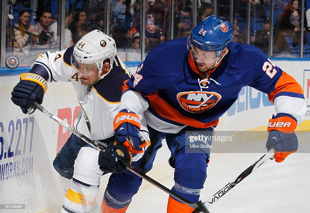 Brad Boyes #24 of the New York Islanders pursues the puck against Andrej Sekera #44 of the Buffalo Sabres at Nassau Veterans Memorial Coliseum on Febuary 9, 2013 in Uniondale, New York.