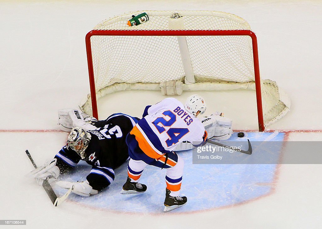 <a gi-track='captionPersonalityLinkClicked' href=/galleries/search?phrase=Brad+Boyes&family=editorial&specificpeople=275014 ng-click='$event.stopPropagation()'>Brad Boyes</a> #24 of the New York Islanders tucks the puck around the pad of a sprawling Ondrej Pavelec #31 of the Winnipeg Jets during the shootout at the MTS Centre on April 20, 2013 in Winnipeg, Manitoba, Canada.