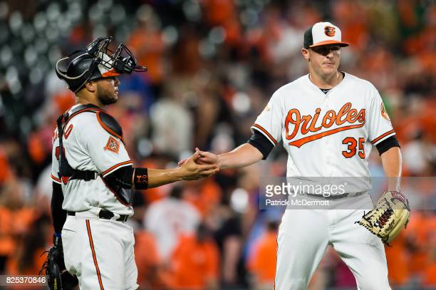 Brad Brach and Welington Castillo of the Baltimore Orioles celebrate after the Orioles defeated the Kansas City Royals 72 at Oriole Park at Camden...