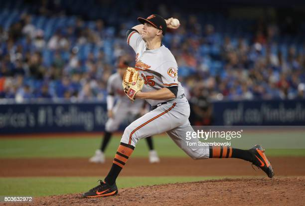 Brad Brach of the Baltimore Orioles delivers a pitch in the ninth inning during MLB game action against the Toronto Blue Jays at Rogers Centre on...