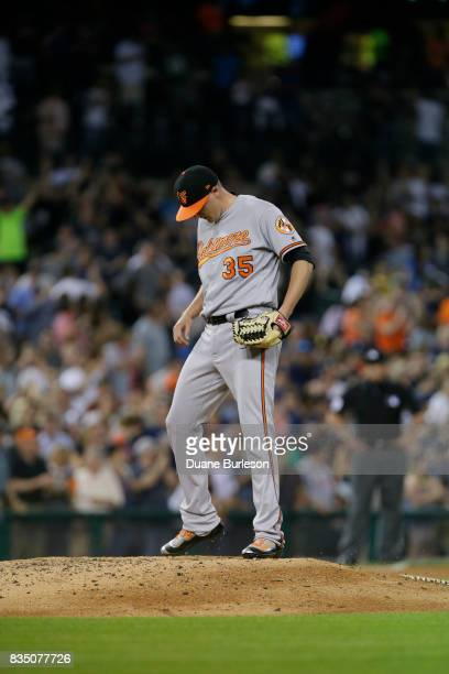 Brad Brach of the Baltimore Orioles kicks at the mound after giving up a home run to JD Martinez of the Detroit Tigers at Comerica Park on May 16...