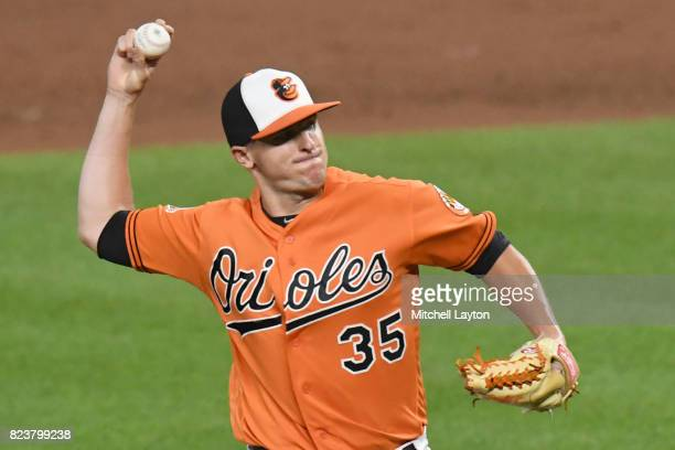 Brad Brach of the Baltimore Orioles pitches during a baseball game against the Houston Astros at Oriole Park at Camden Yards on July 22 2017 in...