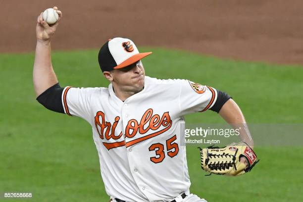 Brad Brach of the Baltimore Orioles pitches during a baseball game against the Boston Red Sox at Oriole Park at Camden Yards on September 18 2017 in...