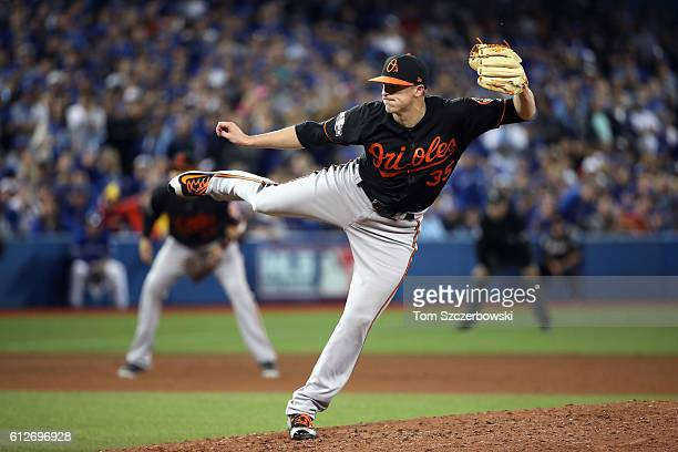 Brad Brach of the Baltimore Orioles throws a pitch in the eighth inning against the Toronto Blue Jays during the American League Wild Card game at...