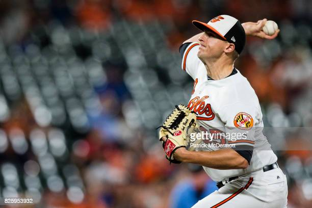 Brad Brach of the Baltimore Orioles throws a pitch to a Kansas City Royals batter in the ninth inning during a game at Oriole Park at Camden Yards on...