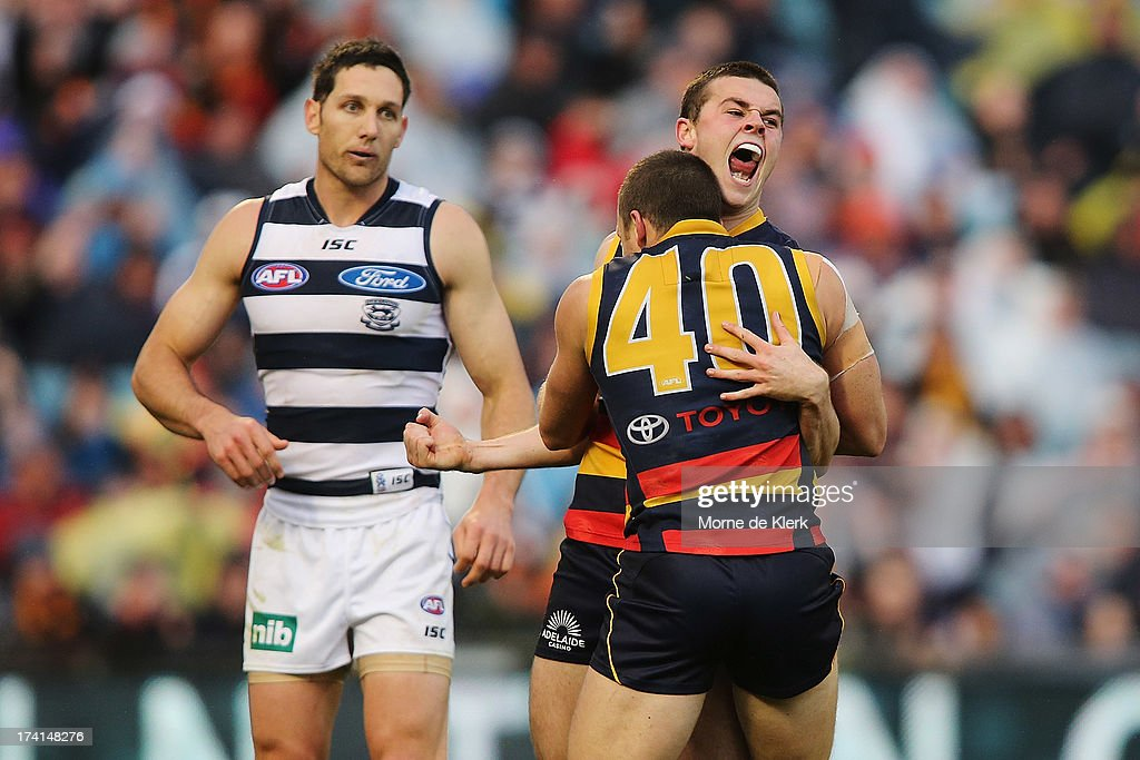 Brad Crouch and Jason Porplyzia of the Crows celebrate after a goal by Crouch during the round 17 AFL match between the Adelaide Crows and the Geelong Cats at AAMI Stadium on July 21, 2013 in Adelaide, Australia.