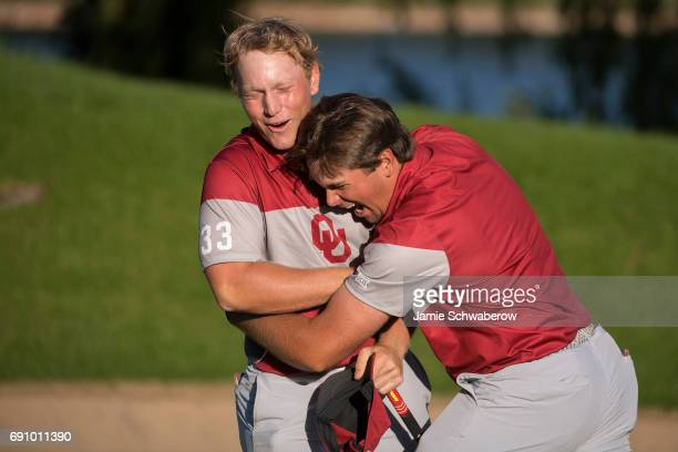Brad Dalke and Blaine Hale of the University of Oklahoma celebrate their victory during the Division I Men's Golf Team Championship held at Rich...