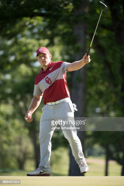 Brad Dalke of the University of Oklahoma celebrates after sinking a putt during the Division I Men's Golf Team Championship held at Rich Harvest...