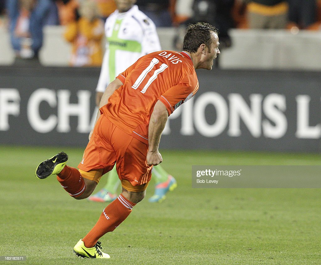 Brad Davis #11 of Houston Dynamo celebrates after scoring in the 89th minute against Santos Laguna during the second half at BBVA Compass Stadium on March 5, 2013 in Houston, Texas.