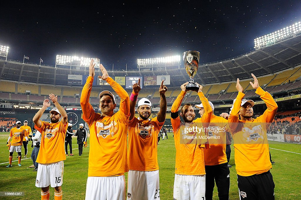 Brad Davis #11 of Houston Dynamo celebrates with his teammates as he holds the MLS 2012 Eastern Conference Championship trophy after defeating D.C. United on an aggregate score of 4-2 at RFK Stadium on November 18, 2012 in Washington, DC.