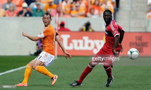 Brad Davis of the Houston Dynamo and Patrick Nyarko of the Chicago Fire during the second half at BBVA Compass Stadium on April 14 2013 in Houston...