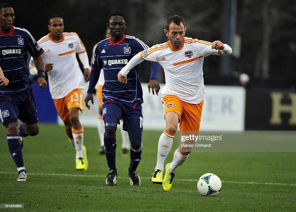 Brad Davis #11 of the Houston Dynamo looks to pass during the first half of their game against the Chicago Fire at Blackbaud Stadium on February 16, 2013 in Charleston, South Carolina.