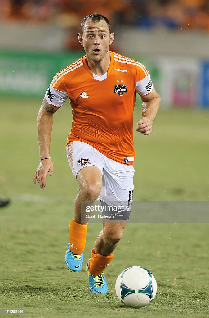 Brad Davis #11 of the Houston Dynamo works the ball against the Chicago Fire at BBVA Compass Stadium on July 27, 2013 in Houston, Texas.