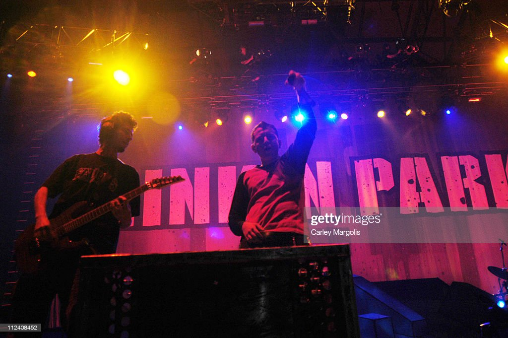 Brad Delson and Chester Bennington of Linkin Park during Linkin Park Meteora World Tour 2004 New York at Nassau Coliseum in Uniondale New York United...