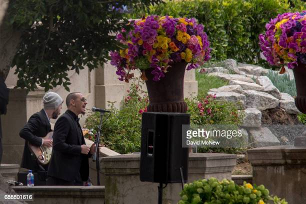 Brad Delson and Chester Bennington perfom during funeral services for Soundgarden frontman Chris Cornell at Hollywood Forever Cemetery on May 26 2017...