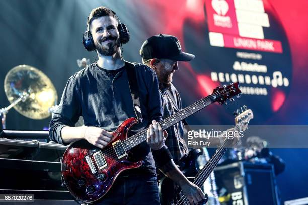 Brad Delson and Dave Farrell of Linkin Park perform on stage at the iHeartRadio Album Release Party presented by State Farm at the iHeartRadio...