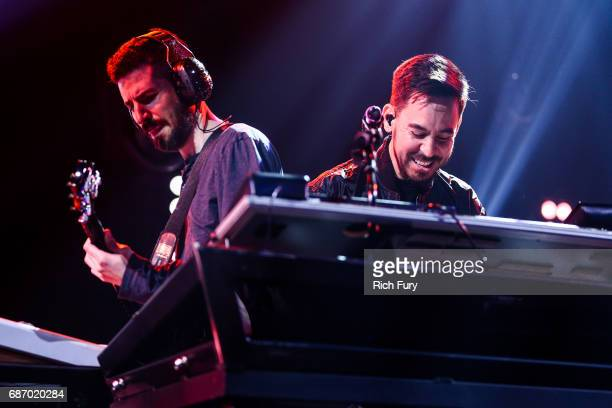 Brad Delson and Mike Shinoda of Linkin Park perform on stage at the iHeartRadio Album Release Party presented by State Farm at the iHeartRadio...