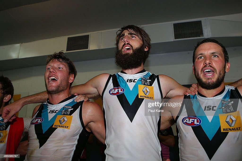Brad Ebert, Justin Westhoff and Travis Boak of the Power sing the club song after winning the round five AFL match between the West Coast Eagles and the Port Power at Patersons Stadium on April 19, 2014 in Perth, Australia.