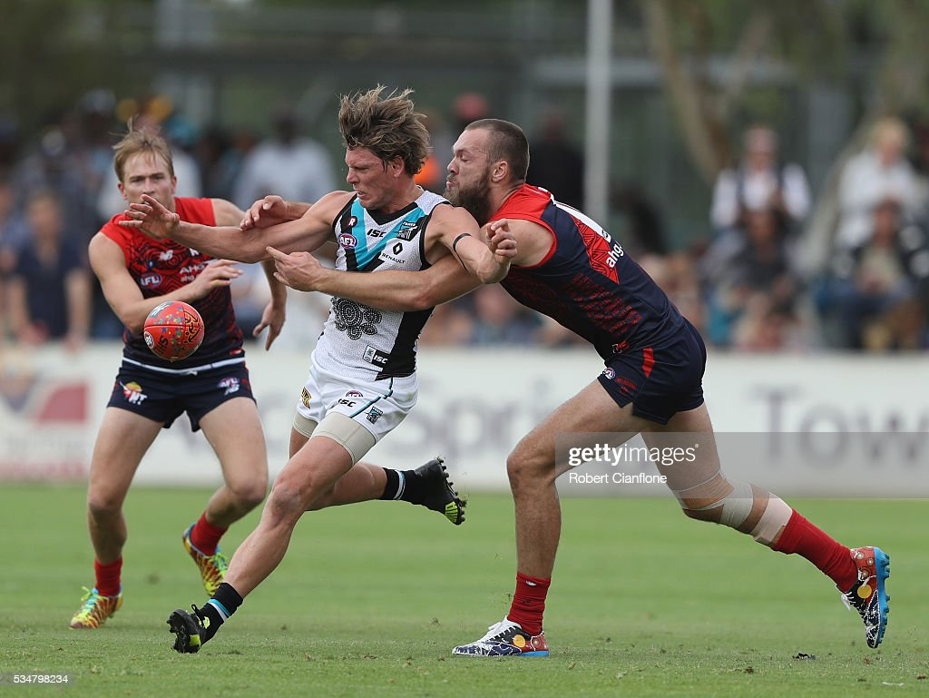 Brad Ebert of Port Adelaide is challenged by Max Gawn of the Demons during the round 10 AFL match between the Melbourne Demons and the Port Adelaide Power at Traeger Park on May 28, 2016 in Alice Springs, Australia.