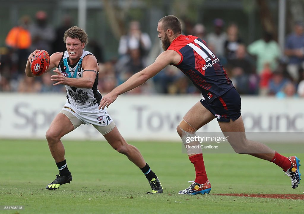 Brad Ebert of Port Adelaide is pressured by Max Gawn of the Demons during the round 10 AFL match between the Melbourne Demons and the Port Adelaide Power at Traeger Park on May 28, 2016 in Alice Springs, Australia.