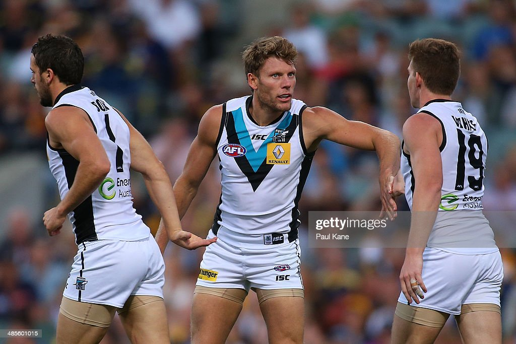 Brad Ebert of the Power celebrates a goal with Matthew Broadbent and Matt White during the round five AFL match between the West Coast Eagles and the Port Power at Patersons Stadium on April 19, 2014 in Perth, Australia.
