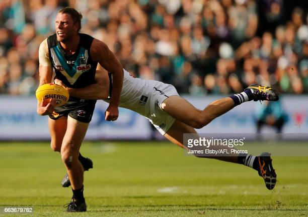 Brad Ebert of the Power is tackled by Joel Hamling of the Dockers during the 2017 AFL round 02 match between the Port Adelaide Power and the...