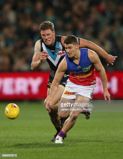 Brad Ebert of the Power tackles Dayne Zorko of the Lions during the 2017 AFL round 13 match between Port Adelaide Power and the Brisbane Lions at the...