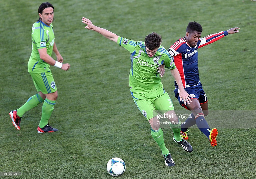 Brad Evans #3 of the Seattle Sounders attempts to control the ball pressured from Clyde Simms #19 of the New England Revolution during FC Tucson Desert Diamond Cup at Kino Sports Complex on February 13, 2013 in Tucson, Arizona. The Sounders defeated the Revolution 2-0.