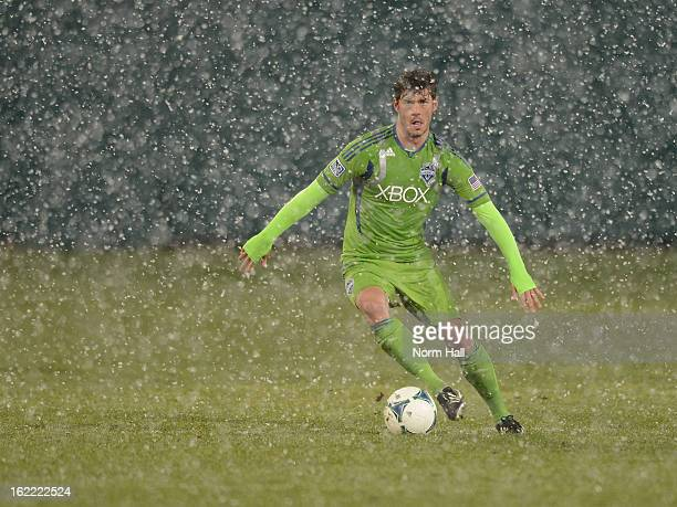 Brad Evans of the Seattle Sounders brings the ball up field in a snow storm against the New York Red Bulls at Kino Sports Complex on February 20 2013...