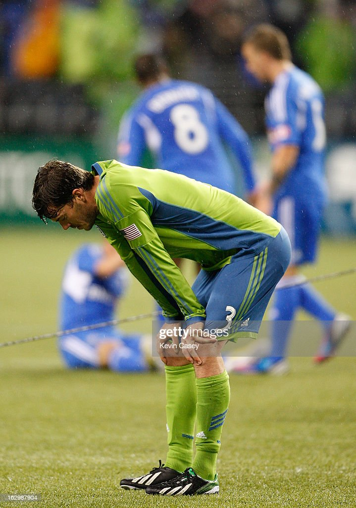 Brad Evans #3, of the Seattle Sounders, stands on the field at the end of the game with Montreal Impact players congratulating themselves at CenturyLink Field on March 2, 2013 in Seattle, Washington.