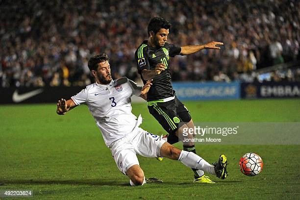 Brad Evans of the United States slides in front of Jesus Corona of Mexico in the second half during the 2017 FIFA Confederations Cup Qualifier at...