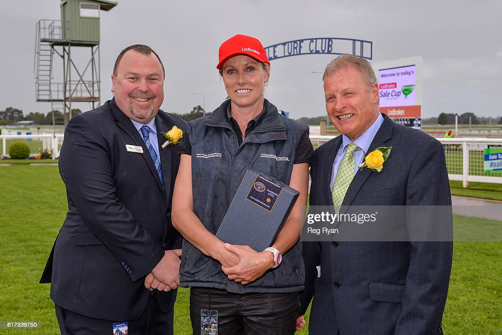 Brad Evans , Sharon Crombie and Ian Rees at the Presentation of Ladbrokes Up For The Challenge BM64 Handicap at Sale Racecourse on October 23, 2016 in Sale, Australia.