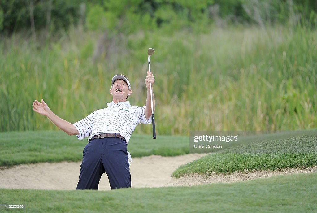 Brad Faxon reacts after a near miss from a bunker on then 8th hole during the final round of the Legends Division at the Liberty Mutual Legends of...