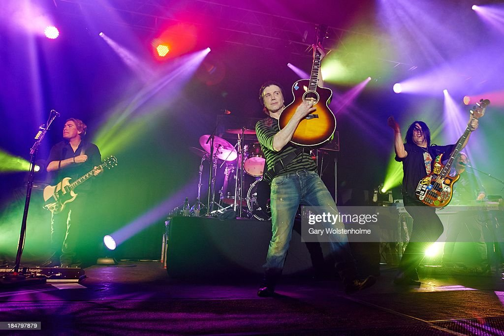 Brad Fernquist, John Rzeznik and Robby Takac of Goo Goo Dolls performs on stage at Manchester Academy on October 16, 2013 in Manchester, England.