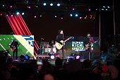 Brad Fernquist John Rzeznik Mike Malinin Robby Takac and Korel Tunador of Goo Goo Dolls perform at Liberty State Park on January 27 2014 in Jersey...