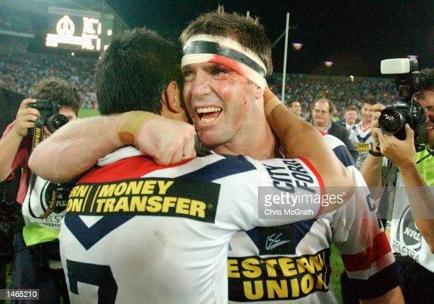 Brad Fittler and Craig Wing of the Roosters celebrate after the teams win over the Warriors in the 2002 NRL Grand Final played between the Sydney...