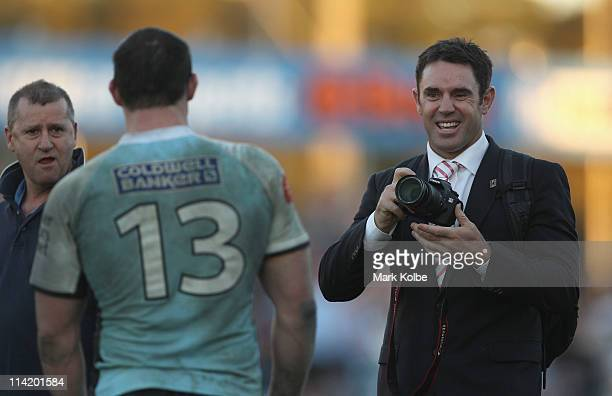Brad Fittler laughs after taking a picture of Paul Gallen of the Sharks after the round 10 NRL match between the Cronulla Sharks and the Sydney...